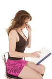 Woman pink skirt book look over glasses Stock Photography