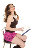 Woman pink skirt sit book hair Royalty Free Stock Images