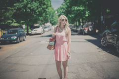Woman in Pink Sleeveless Dress Wearing Sunglasses Taking Selfie during Daytime Stock Photography
