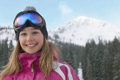 Woman In Pink Snow Coat And Ski Glasses Stock Photos