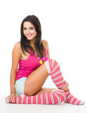 Woman in pink socks with long hair sit and look at Stock Image