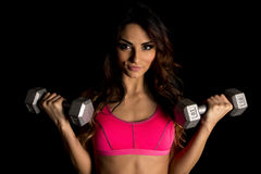 Woman in pink sports bra on black curl close Royalty Free Stock Images