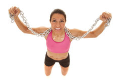 Woman pink sports bra chain kneel Royalty Free Stock Image