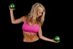 Woman pink sports bra green balls side Royalty Free Stock Images