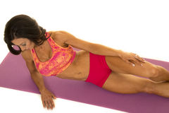 Woman in pink sports outfit lay back top view Stock Photo