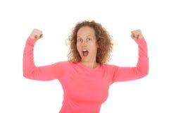 Woman pink sports shirt flex Stock Photo