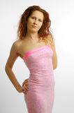 Woman in the pink strapless dress Stock Photography