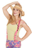Woman pink suspenders hat hold Stock Photo
