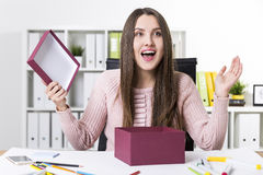 Woman in a pink sweater is happy to get her gift stock photo