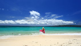Woman with pink swimming mattress on tropical beach, Boracay. Woman with pink swimming mattress on tropical beach, Philippines, Boracay stock footage