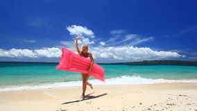 Woman with pink swimming mattress on tropical beach, Boracay. Woman with pink swimming mattress on tropical beach, Philippines, Boracay stock video footage