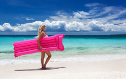 Woman with pink swimming mattress on tropical beach, Philippines Royalty Free Stock Photo
