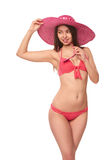 Woman in pink swimsuit and hat Royalty Free Stock Image