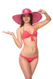 Woman in pink swimsuit and hat Royalty Free Stock Photography