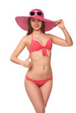 Woman in pink swimsuit and hat Royalty Free Stock Images