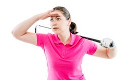 Woman in pink T-shirt with a golf club looks into the distance stock images