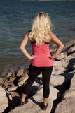 Woman pink tank back water Royalty Free Stock Photography