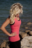 Woman pink tank look down water Stock Photography