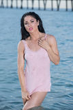 Woman in a pink tank top at the beach. Stock Photography
