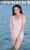 Woman in a pink tank top at the beach. Royalty Free Stock Images