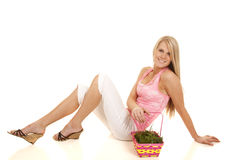 Woman pink tank top easter basket sit back Royalty Free Stock Photo