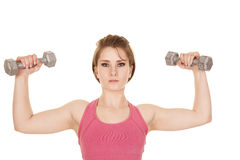 Woman pink tank top flex with weights up Royalty Free Stock Photos