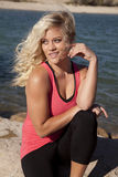 Woman pink tank water look side. Royalty Free Stock Image