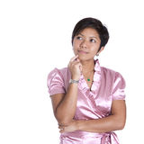 Woman in pink in thinking pose Royalty Free Stock Images