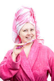 Woman in pink with tooth brush Stock Image