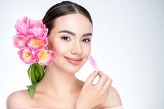 Woman with pink tulips bouquet Stock Photos