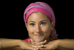 Woman with pink turban. And pink earrings Stock Images