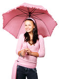 Woman with pink umbrella. Young woman with pink umbrella isolated on white background Royalty Free Stock Image