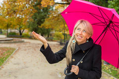 Woman with pink umbrella enjoying rainy autumn weather Royalty Free Stock Photos