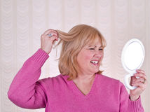 Woman in Pink Unsatisfied with Hair Royalty Free Stock Photos
