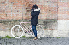 Woman with pink vintage Bicycle with white wheels Stock Image