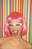 Woman in pink wig. Royalty Free Stock Image
