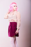 Woman with pink wig creative visage Stock Photo