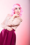 Woman with pink wig creative visage Stock Photos