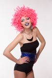 Woman in pink wig with silver ball Stock Images