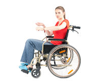 Woman pinned to wheelchair by handcuffs Stock Photos