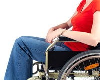 Woman pinned to wheelchair by handcuffs Stock Photo