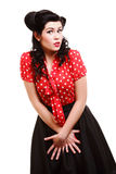 Woman pinup makeup hairstyle posing in studio Stock Photography