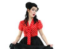 Woman pinup makeup hairstyle posing in studio Royalty Free Stock Photography