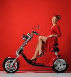 Woman pinup style ride new electric car motorcycle bicycle scooter present for new year 2019 royalty free stock images