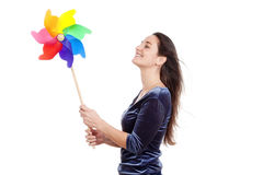 Woman with pinwheel Royalty Free Stock Photography