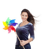 Woman with pinwheel Royalty Free Stock Photos
