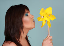 Woman and pinwheel Stock Image