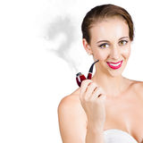 Woman with pipe Royalty Free Stock Photo