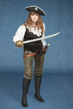 Woman - pirate armed with a sabre on blue Stock Photography