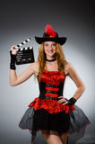 Woman in pirate costume. With movie board stock photo